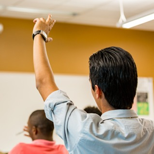 Student with Hand Up