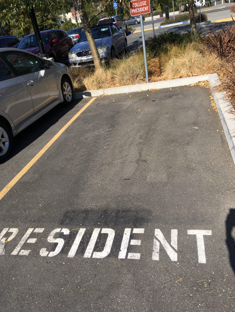 Picture of presidents parking spot with no car in it.